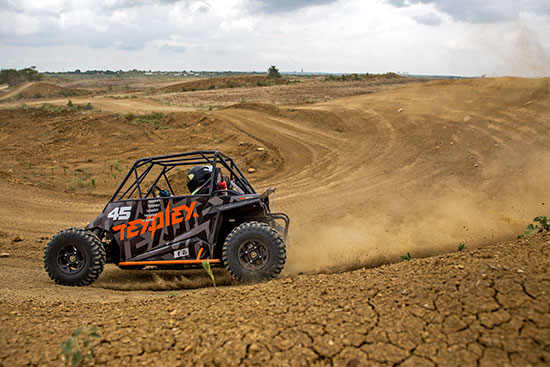guest driving a utv on the track at Texplex Park